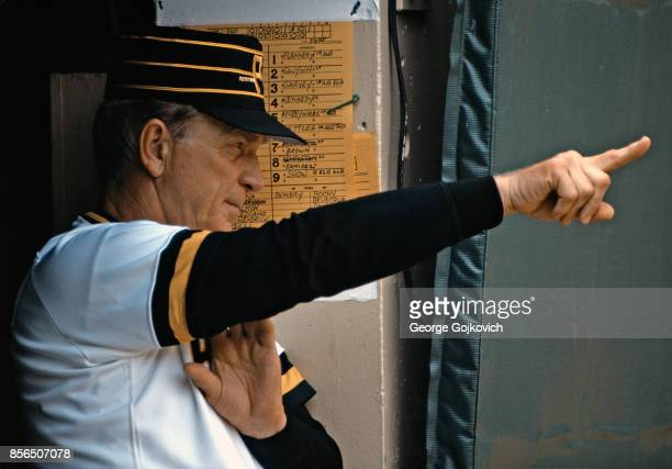 Manager Chuck Tanner of the Pittsburgh Pirates signals from the dugout during a Major League Baseball game against the San Diego Padres at Three...