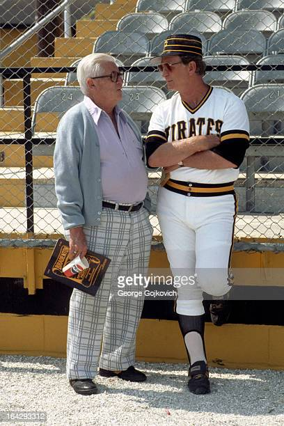 Manager Chuck Tanner of the Pittsburgh Pirates talks to scout Howie Haak before a Major League Baseball spring training game at McKechnie Field circa...
