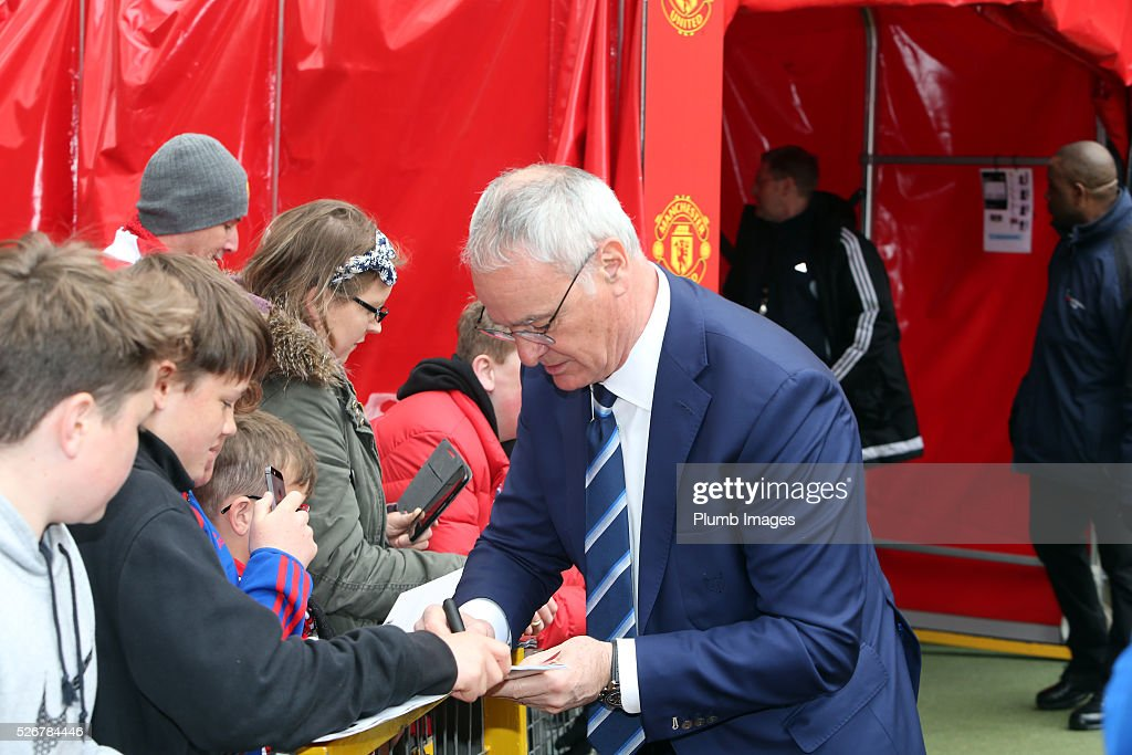 Manager Claudio Ranieri of Leicester City signs autographs at Old Trafford ahead of the Premier League match between Manchester United and Leicester City at Old Trafford on May 01, 2016 in Manchester, United Kingdom.