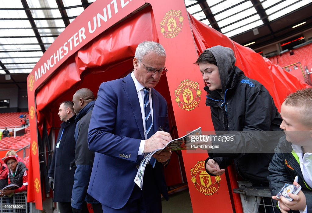 Manager <a gi-track='captionPersonalityLinkClicked' href=/galleries/search?phrase=Claudio+Ranieri&family=editorial&specificpeople=204468 ng-click='$event.stopPropagation()'>Claudio Ranieri</a> of Leicester City signs autographs at Old Trafford ahead of the Premier League match between Manchester United and Leicester City at Old Trafford on May 01, 2016 in Manchester, United Kingdom.