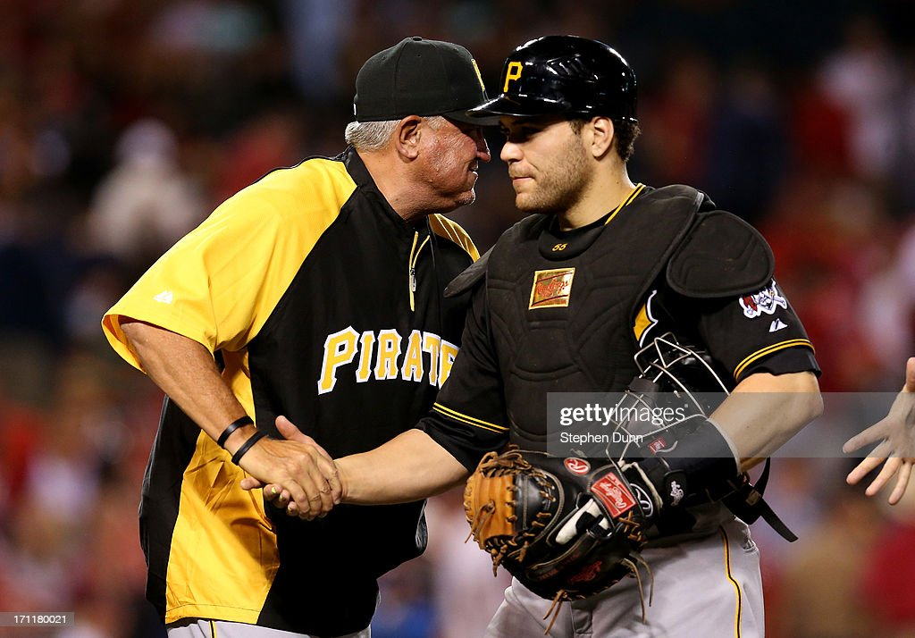 Manager Clint Hurdle (L)) and catcher Russell Martin #55 of the Pittsburgh Pirates shake hands after the game against the Los Angeles Angels of Anaheim at Angel Stadium of Anaheim on June 22, 2013 in Anaheim, California. The Pirates won 6-1.