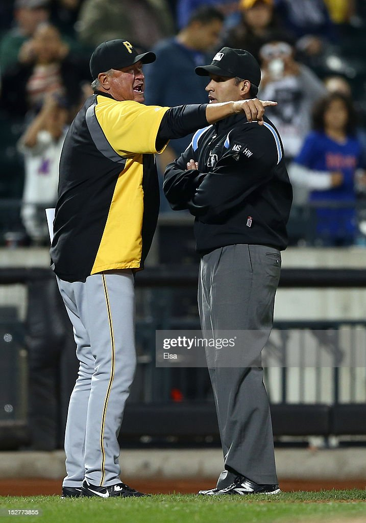Manager <a gi-track='captionPersonalityLinkClicked' href=/galleries/search?phrase=Clint+Hurdle&family=editorial&specificpeople=223975 ng-click='$event.stopPropagation()'>Clint Hurdle</a> #13 argues a call with third base umpire Manny Gonzalez in the seventh inning against the New York Mets on September 25, 2012 at Citi Field in the Flushing neighborhood of the Queens borough of New York City.