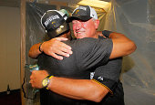 Manager Clint Hurdle hugs Starling Marte of the Pittsburgh Pirates as they celebrate clinching a National League playoff spot after their 32 win over...