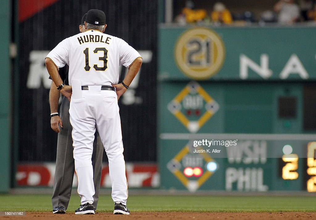 Manager Clint Hurdle #13 of the Pittsburgh Pirates argues a call against the Milwaukee Brewers during the game on August 25, 2012 at PNC Park in Pittsburgh, Pennsylvania.
