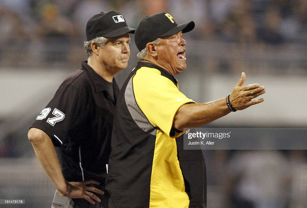 Manager Clint Hurdle #13 of the Pittsburgh Pirates argues a call at third and is ejected in the sixth inning against the Chicago Cubs during the game on September 7, 2012 at PNC Park in Pittsburgh, Pennsylvania.