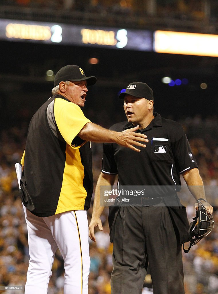 Manager <a gi-track='captionPersonalityLinkClicked' href=/galleries/search?phrase=Clint+Hurdle&family=editorial&specificpeople=223975 ng-click='$event.stopPropagation()'>Clint Hurdle</a> #13 of the Pittsburgh Pirates argues after home plate umpire Mark Carlson warned both teams following Andrew McCutchen of the Pirates being hit by a pitch in the eighth inning during the game on September 20, 2013 at PNC Park in Pittsburgh, Pennsylvania.