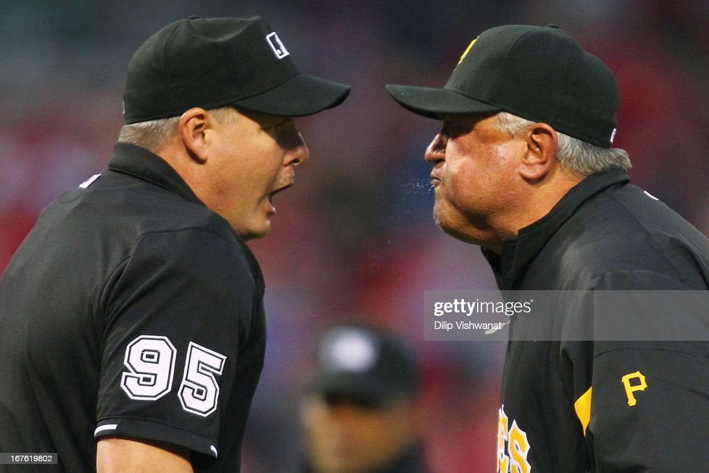Manager Clint Hurdle of the Pittsburgh Pirates argues with Umpire Tim Timmons after starter Jonathan Sanchez also of the Pittsburgh Pirates was...