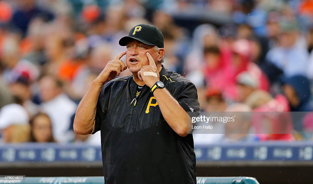 Manager Clint Hurdle of the Pittsburgh Pirates asks the crew chief for a video replay during the first inning of the interleague game against the...