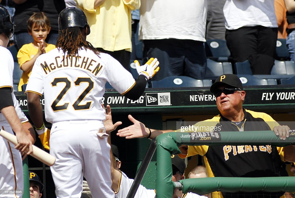 Manager Clint Hurdle #13 of the Pittsburgh Pirates celebrates with Andrew McCutchen #22 after a solo home run in the first inning against the Chicago Cubs during the game on September 9, 2012 at PNC Park in Pittsburgh, Pennsylvania.