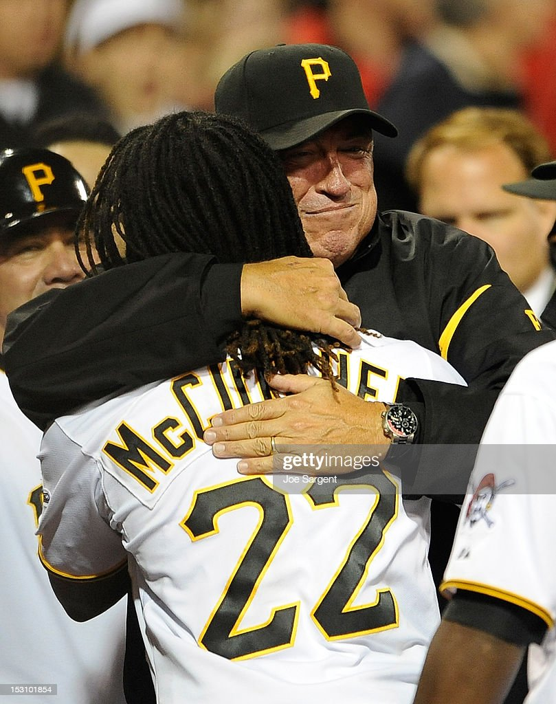 Manager Clint Hurdle of the Pittsburgh Pirates celebrates with Andrew McCutchen #22 after his ninth inning walk off home run against the Cincinnati Reds on September 29, 2012 at PNC Park in Pittsburgh, Pennsylvania.