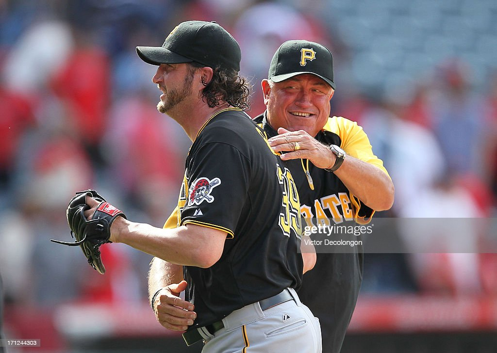 Manager Clint Hurdle #13 of the Pittsburgh Pirates congratulates pitcher Jason Grilli #39 after the Pittsburgh Pirates defeated the Los Angeles Angels of Anaheim 10-9 in ten inning in the MLB game at Angel Stadium of Anaheim on June 23, 2013 in Anaheim, California.