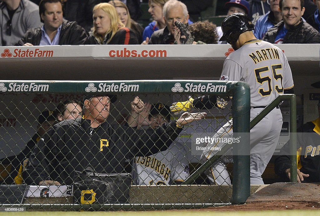 Manager <a gi-track='captionPersonalityLinkClicked' href=/galleries/search?phrase=Clint+Hurdle&family=editorial&specificpeople=223975 ng-click='$event.stopPropagation()'>Clint Hurdle</a> #13 of the Pittsburgh Pirates (L) congratulates <a gi-track='captionPersonalityLinkClicked' href=/galleries/search?phrase=Russell+Martin+-+Baseball+Player&family=editorial&specificpeople=13764024 ng-click='$event.stopPropagation()'>Russell Martin</a> #55 after Martin hit a solo home run during the seventh inning against the Chicago Cubs at Wrigley Field on April 9, 2014 in Chicago, Illinois.
