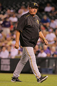 Manager Clint Hurdle of the Pittsburgh Pirates goes to the mound to make a pitching change against the Colorado Rockies at Coors Field on September...