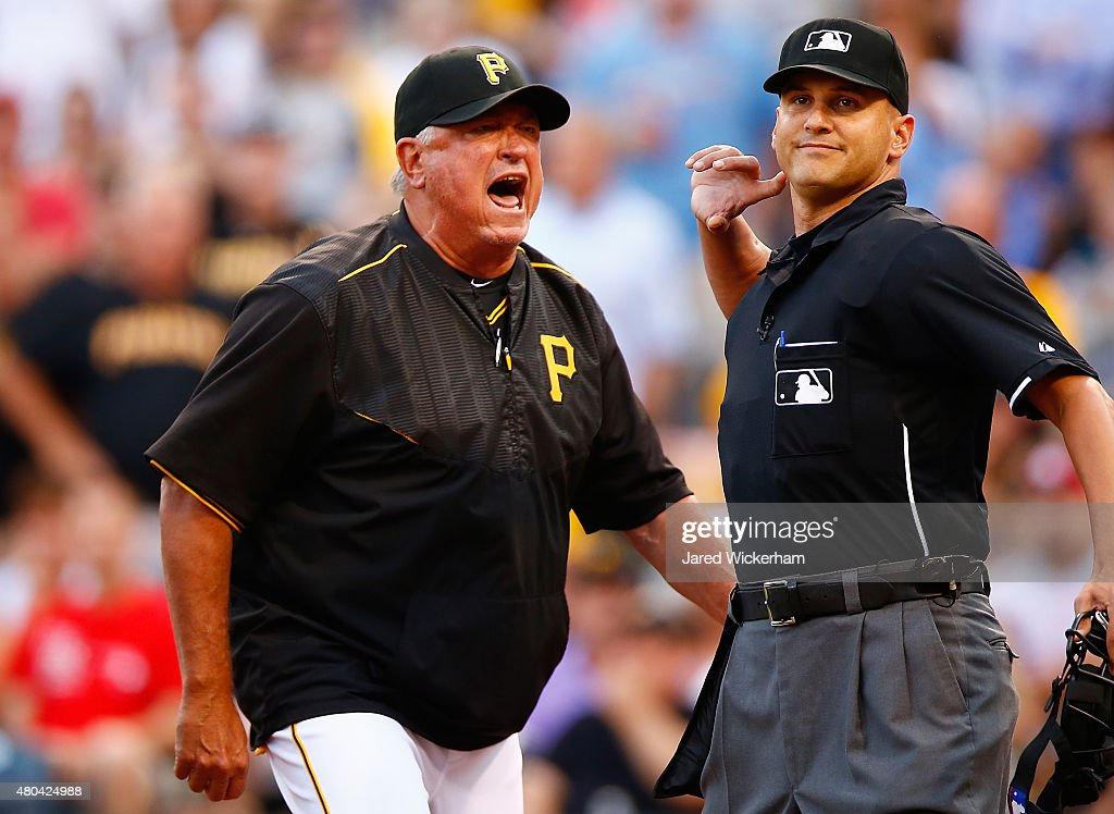 Manager Clint Hurdle #13 of the Pittsburgh Pirates is ejected by home plate umpire Vic Carapazza in the second inning following a called foul bal that resulted in a home run by Mark Reynolds #12 of the St Louis Cardinals during the game at PNC Park on July 11, 2015 in Pittsburgh, Pennsylvania.