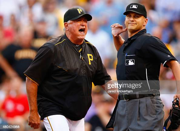 Manager Clint Hurdle of the Pittsburgh Pirates is ejected by home plate umpire Vic Carapazza in the second inning following a called foul bal that...