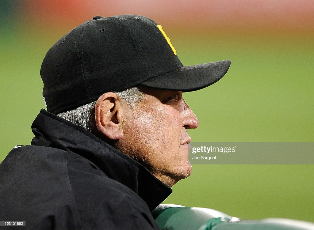 Manager Clint Hurdle #13 of the Pittsburgh Pirates looks on during the game against the Cincinnati Reds on September 29, 2012 at PNC Park in Pittsburgh, Pennsylvania.
