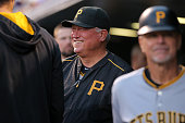 Manager Clint Hurdle of the Pittsburgh Pirates looks on from the dugout as he prepares to lead his team against the Colorado Rockies at Coors Field...
