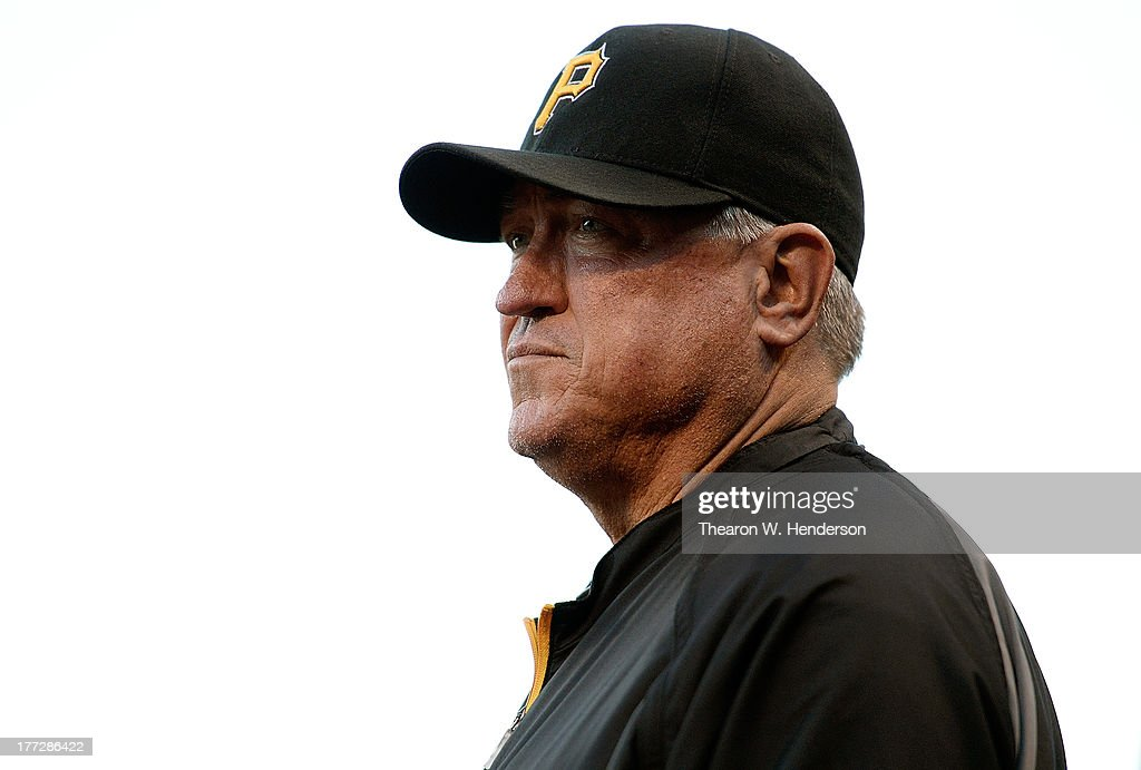 Manager <a gi-track='captionPersonalityLinkClicked' href=/galleries/search?phrase=Clint+Hurdle&family=editorial&specificpeople=223975 ng-click='$event.stopPropagation()'>Clint Hurdle</a> #13 of the Pittsburgh Pirates looks on from the dugout against the San Francisco Giants at AT&T Park on August 22, 2013 in San Francisco, California.