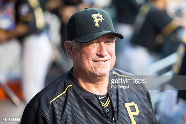 Manager Clint Hurdle of the Pittsburgh Pirates looks on from the dugout during the game against the New York Mets at Citi Field on August 14 2015 in...
