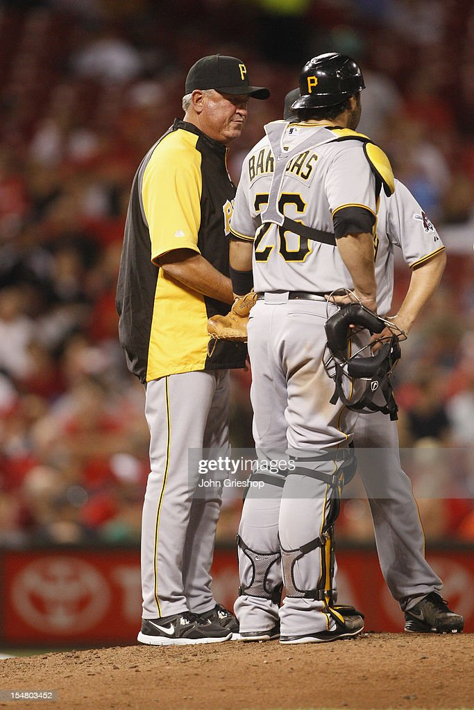 Manager Clint Hurdle #13 of the Pittsburgh Pirates makes a pitching change during the game against the Cincinnati Reds at Great American Ball Park on September 10, 2012 in Cincinnati, Ohio.