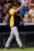 Manager Clint Hurdle of the Pittsburgh Pirates motions to the bullpen as he heads to the mound to insert Vin Mazzaro of the Pittsburgh Pirates to...