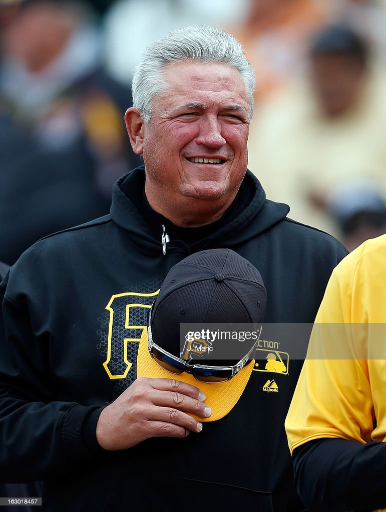 Manager Clint Hurdle #13 of the Pittsburgh Pirates smiles against the Houston Astros during a Grapefruit League Spring Training Game at McKechnie Field on March 3, 2013 in Bradenton, Florida.