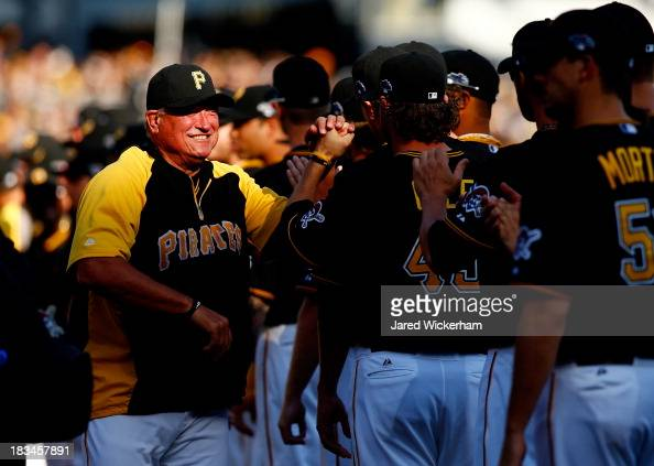 Manager Clint Hurdle of the Pittsburgh Pirates takes the field before Game Three of the National League Division Series against the St Louis...