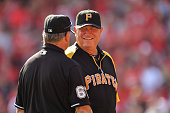 Manager Clint Hurdle of the Pittsburgh Pirates talks with umpire Jim Joyce during a game against the Cincinnati Reds at Great American Ball Park on...