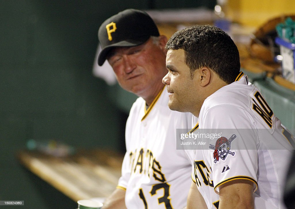 Manager Clint Hurdle #13 of the Pittsburgh Pirates talks with Wandy Rodriguez #51 after being pulled from the game against the Los Angeles Dodgers during the game on August 15, 2012 at PNC Park in Pittsburgh, Pennsylvania.