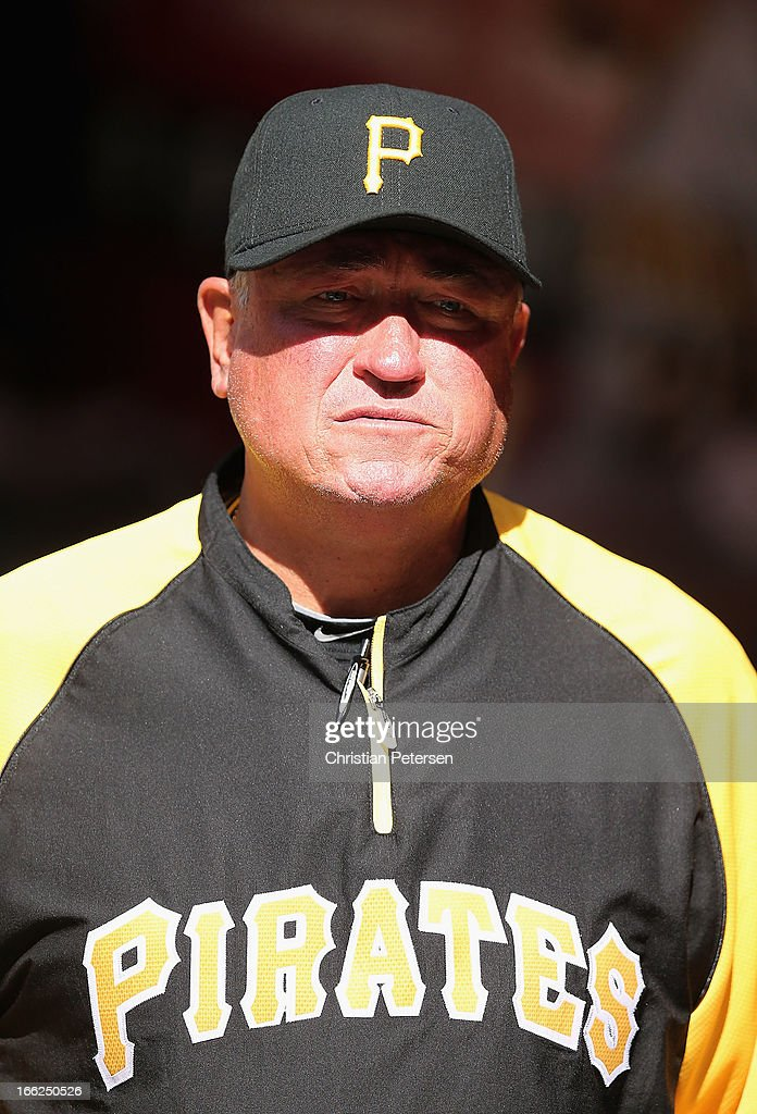 Manager Clint Hurdle #13 of the Pittsburgh Pirates walks in the duogut during the MLB game against the Arizona Diamondbacks at Chase Field on April 10, 2013 in Phoenix, Arizona. The Diamondbacks defeated the Pirates 10-2.