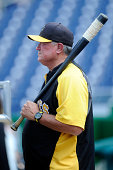 Manager Clint Hurdle of the Pittsburgh Pirates watches batting practice before the game against the Washington Nationals at Nationals Park on August...