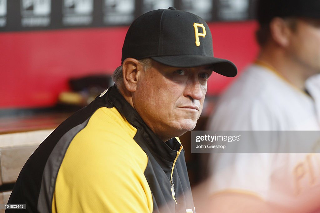 Manager Clint Hurdle #13 of the Pittsburgh Pirates watches his team from the dugout during the game against the Cincinnati Reds at Great American Ball Park on September 10, 2012 in Cincinnati, Ohio.