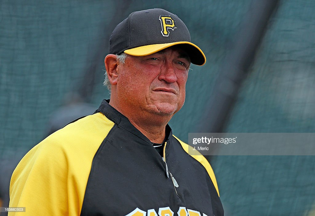Manager Clint Hurdle #13 of the Pittsburgh Pirates watches his team during batting practice just before the start of the Grapefruit League Spring Training Game against the New York Yankees at McKechnie Field on March 17, 2013 in Bradenton, Florida.