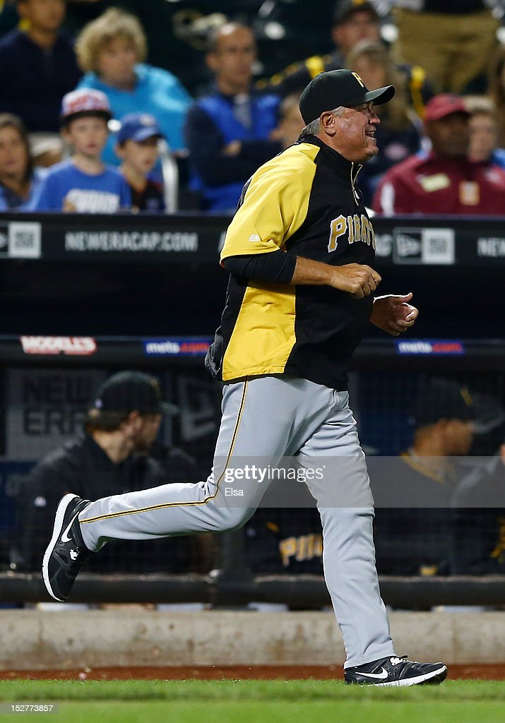 Manager Clint Hurdle #13 runs out to argue a call with third base umpire Manny Gonzalez in the seventh inning against the New York Mets on September 25, 2012 at Citi Field in the Flushing neighborhood of the Queens borough of New York City.