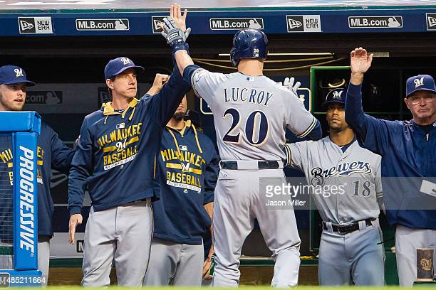Manager Craig Counsell celebrates with Jonathan Lucroy of the Milwaukee Brewers after Lucroy hit a solo home run during the first inning against the...