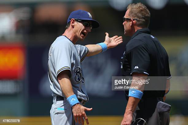 Manager Craig Counsell of the Milwaukee Brewers argues a call with home plate umpire Jim Wolf during the first inning against the Colorado Rockies at...