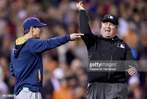 Manager Craig Counsell of the Milwaukee Brewers gets thrown out of the game by third base umpire Gerry Davis in the top of the ninth inning against...