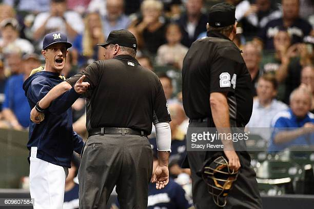 Manager Craig Counsell of the Milwaukee Brewers is ejected by home plate umpire Jerry Layne during the third inning of a game against the Pittsburgh...