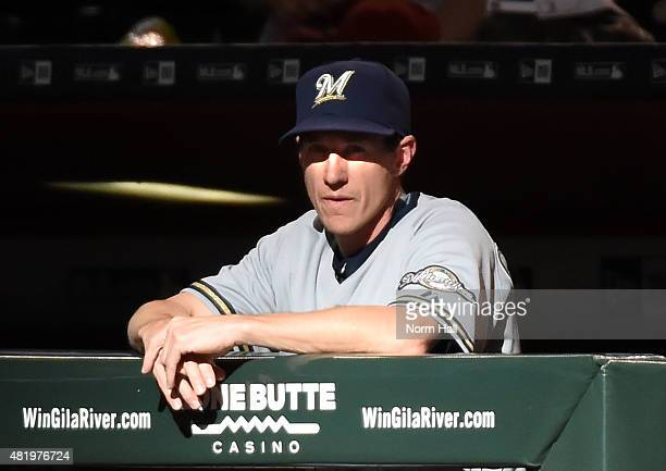 Manager Craig Counsell of the Milwaukee Brewers looks on from the bench during the first inning against the Arizona Diamondbacks at Chase Field on...