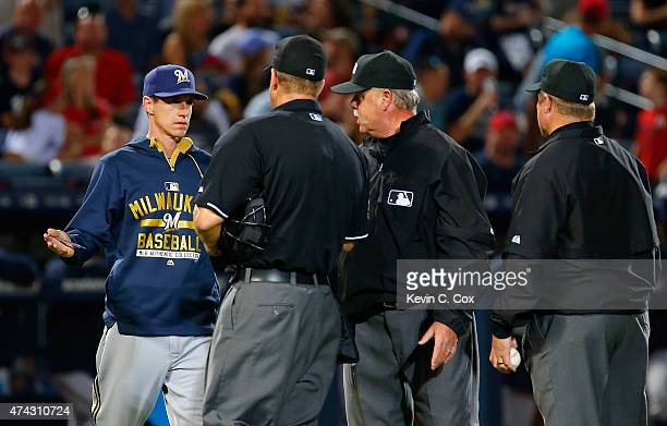 Manager Craig Counsell of the Milwaukee Brewers questions the umpires after Will Smith was ejected in the seventh inning against the Atlanta Braves...