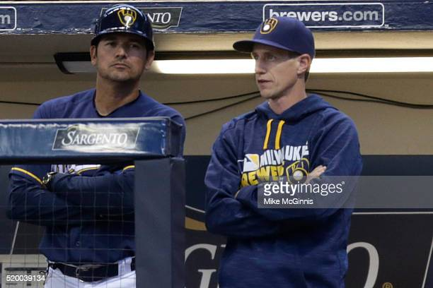 Manager Craig Counsell of the Milwaukee Brewers talks in the dugout during the first inning against the Houston Astros at Miller Park on April 09...