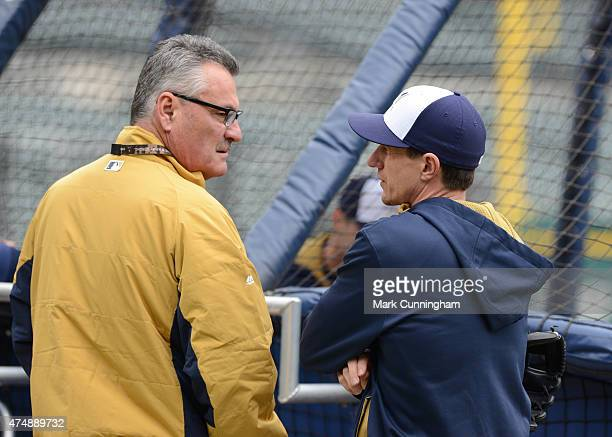 Manager Craig Counsell of the Milwaukee Brewers talks with Fox Sports Wisconsin Broadcaster and former Brewer Bill Schroeder prior to the game...