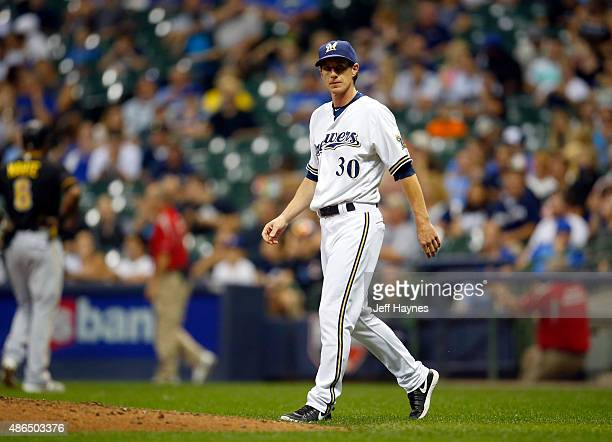 Manager Craig Counsell of the Milwaukee Brewers walks to the mound during a game against the Pittsburgh Pirates at Miller Park on September 3 2015 in...