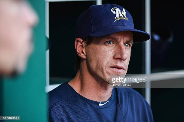 Manager Craig Counsell of the Milwaukee Brewers watches his team from the dugout against the Cincinnati Reds at Great American Ball Park on September...