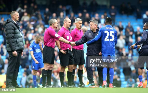 Manager Craig Shakespeare of Leicester City with referee Robert Madley after the Premier League match between Manchester City and Leicester City at...