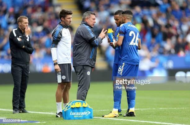 Manager Craig Shakespeare of Leicester City with Riyad Mahrez and Danny Simpson of Leicester City during the Premier League match between Leicester...