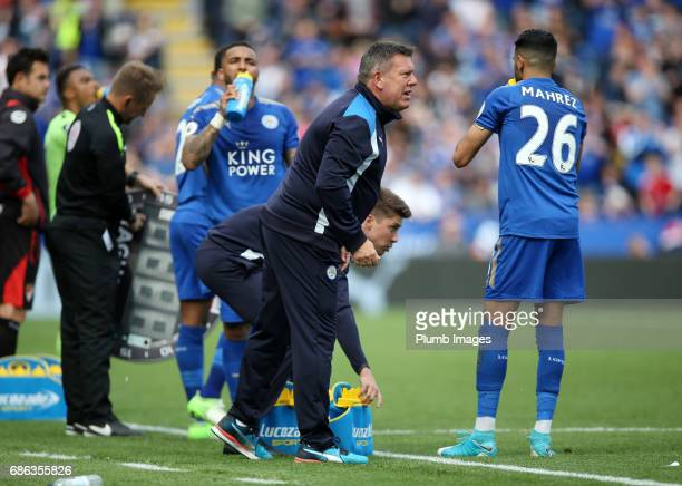Manager Craig Shakespeare of Leicester City with Riyad Mahrez of Leicester City during the Premier League match between Leicester City and...