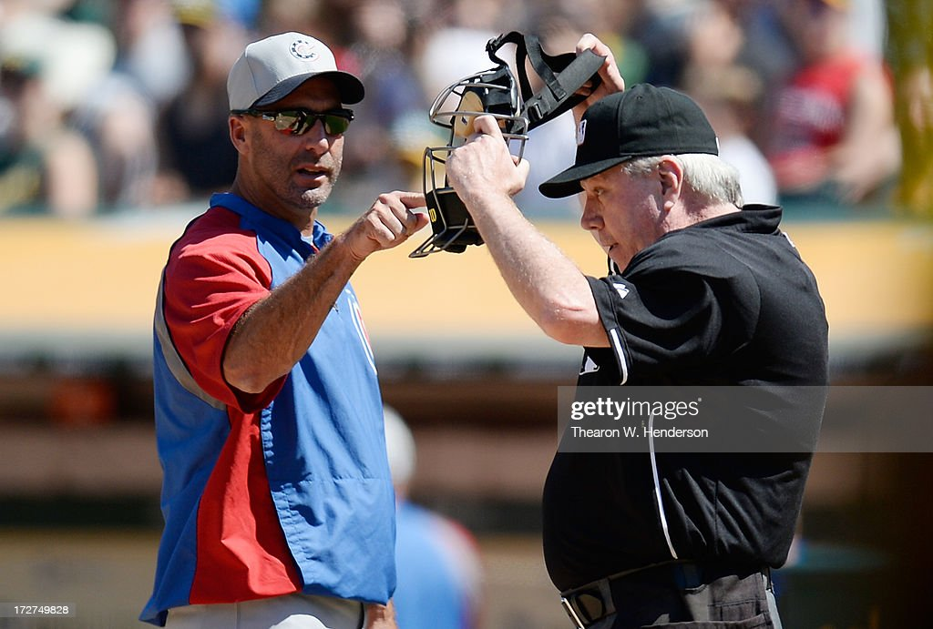 Manager Dale Sveum #4 of the Chicago Cubs argues with home plate umpire <a gi-track='captionPersonalityLinkClicked' href=/galleries/search?phrase=Brian+Gorman&family=editorial&specificpeople=194921 ng-click='$event.stopPropagation()'>Brian Gorman</a> #9 in the eighth inning during a Major League Game against the Oakland Athletics at O.co Coliseum on July 4, 2013 in Oakland, California.
