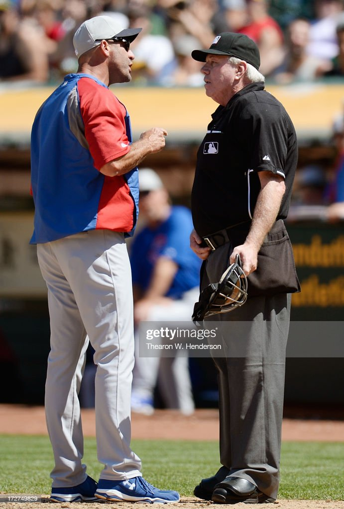 Manager Dale Sveum #4 of the Chicago Cubs argues with home plate umpire Brian Gorman #9 in the eighth inning during a Major League Game against the Oakland Athletics at O.co Coliseum on July 4, 2013 in Oakland, California.