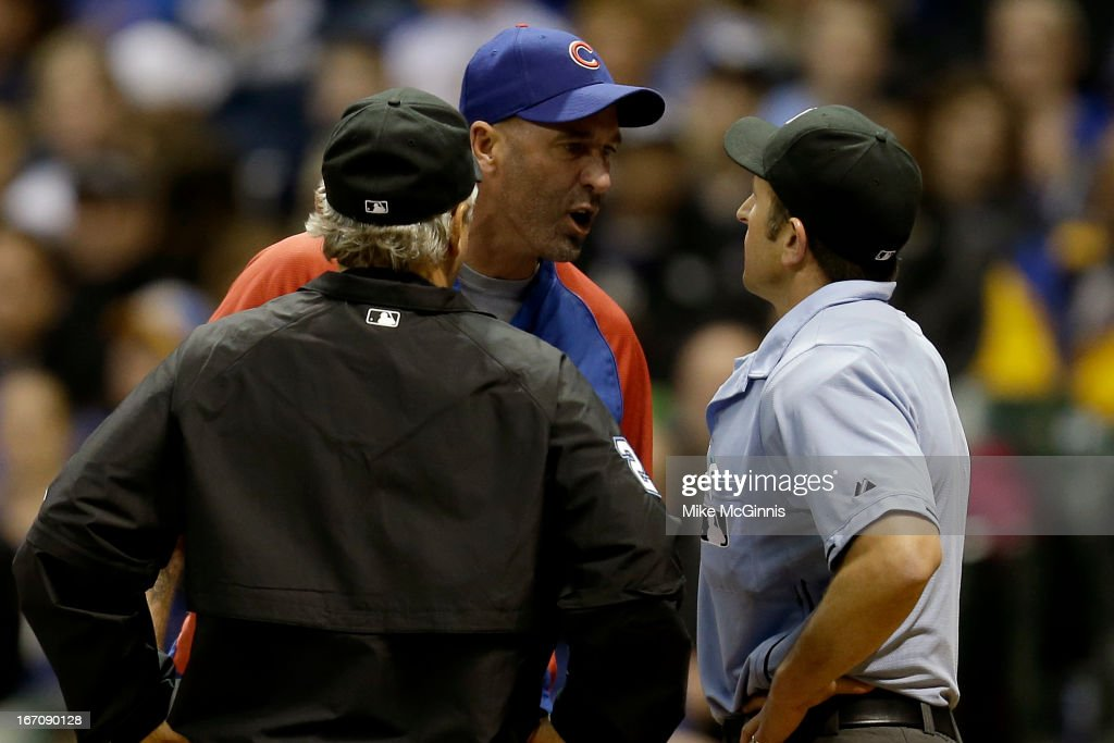 Manager Dale Sveum #4 of the Chicago Cubs gets ejected by home plate umpire Chris Guccione #68 during the bottom of the sixth inning against the Milwaukee Brewers at Miller Park on April 19, 2013 in Milwaukee, Wisconsin.